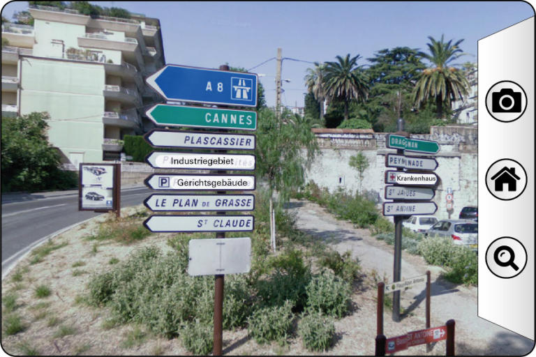 Mockup of the transparent display showing some road signs that are translated from French to German.