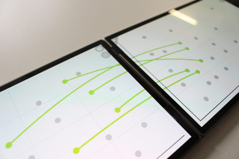 Showing links between data items on two different tablets