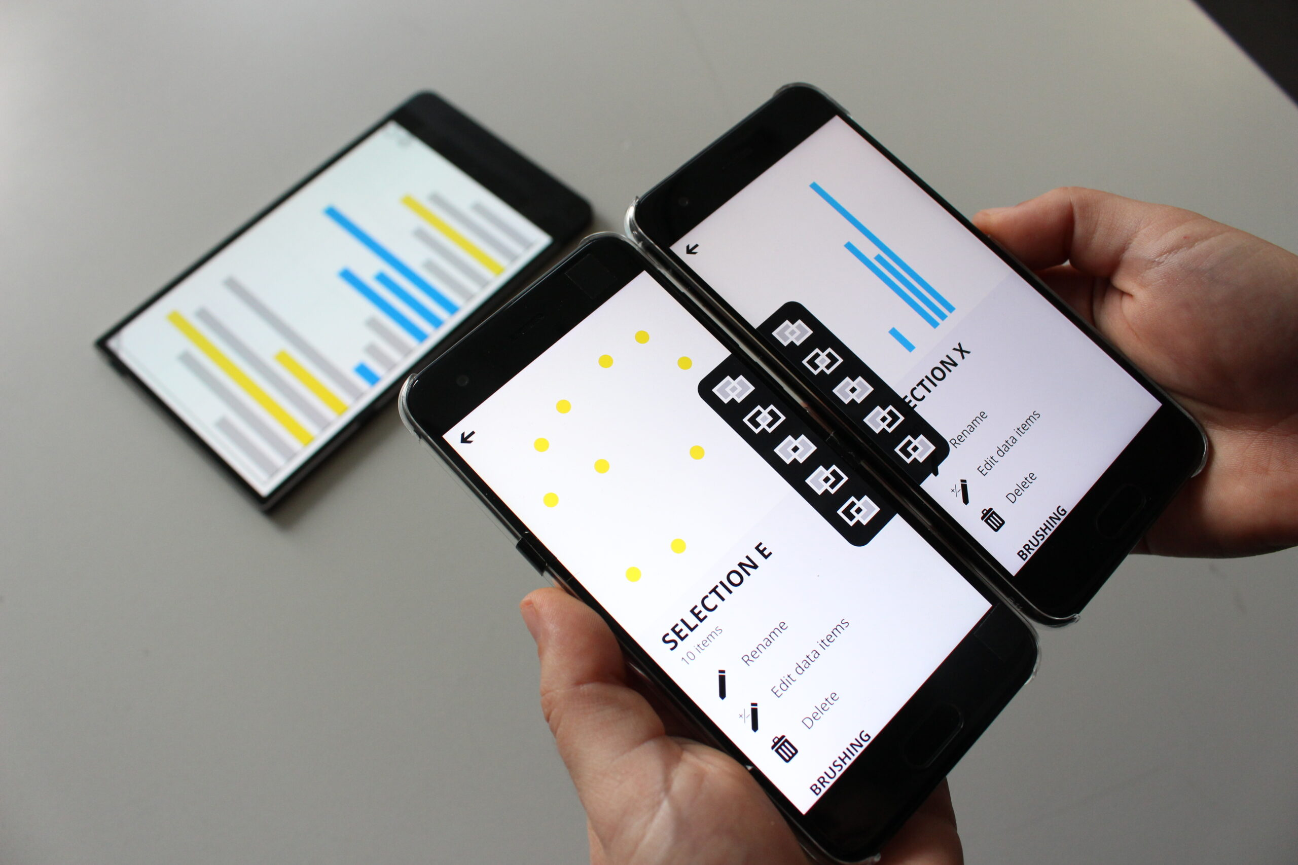 Two smartphones, each representing a selection, next to each other and showing a menu for applying operations.